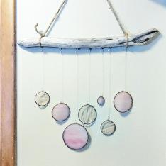 // glass and driftwood nursery wall handing
